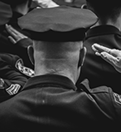 Law enforcement officers saluting