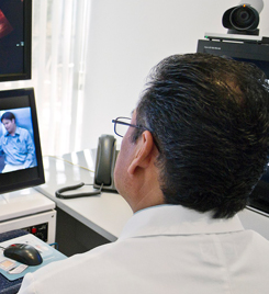 Clinician conducting a telemedicine forensic exam
