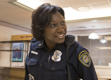 Smiling female officer in precinct