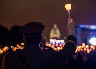 Police officer with lit candle