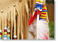 Photo of American Indian clothing and feather.