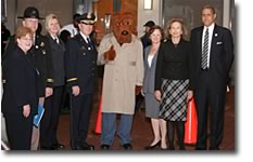 McGruff the Crime Dog, with Mary Lou Leary, OJP's Acting Assistant Attorney General, are pictured with representatives from the National Crime Prevention Council, the U.S. Attorney's Office in the District of Columbia, the District of Columbia government, and the National Sheriffs' Association to Celebrate Safe Communities.