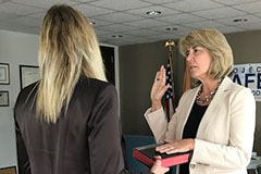 Kendel Ehrlich being sworn in as SMART Office Director