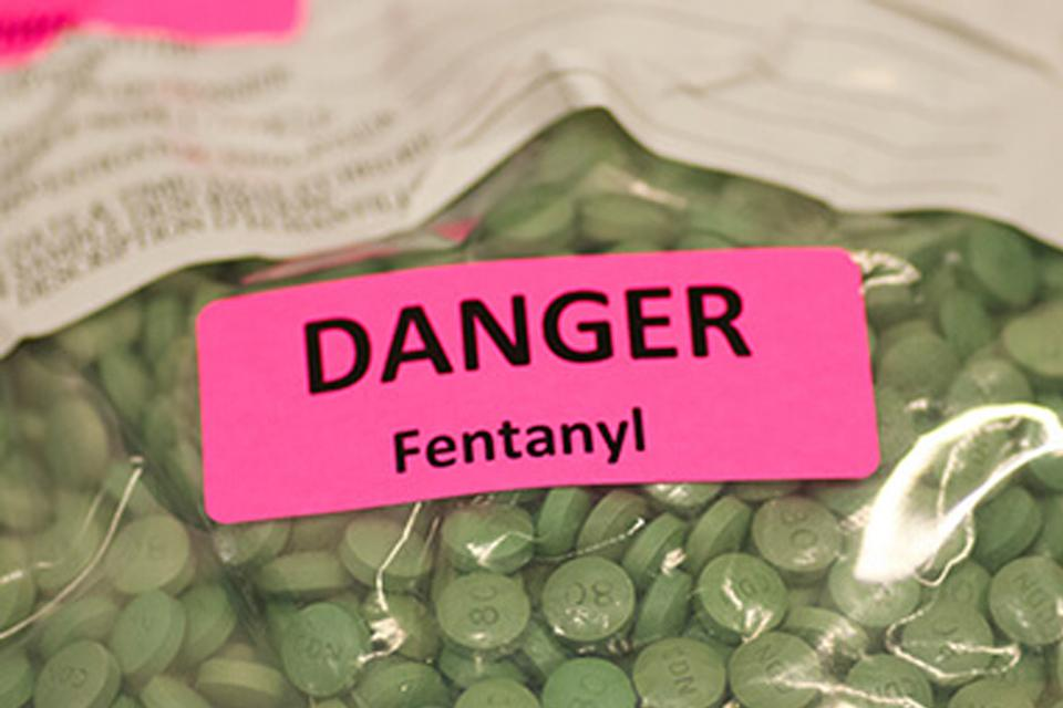 Plastic bag of green pills marked Fentanyl