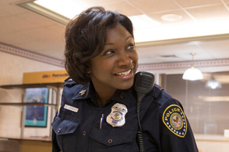 Smiling female officer in precinct