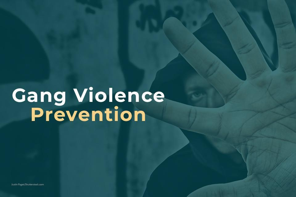 Gang violence prevention image of a man with his hand in front of his face