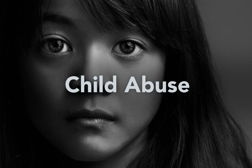 Child Abuse text on background of child's face