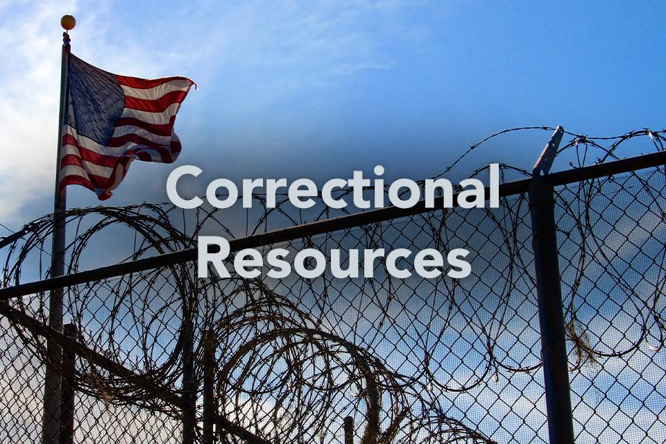 Correctional Resources on background of flag behind barbed wire fence