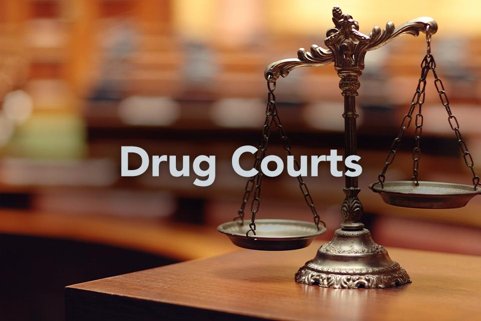 Drug Courts on background of scales of justice